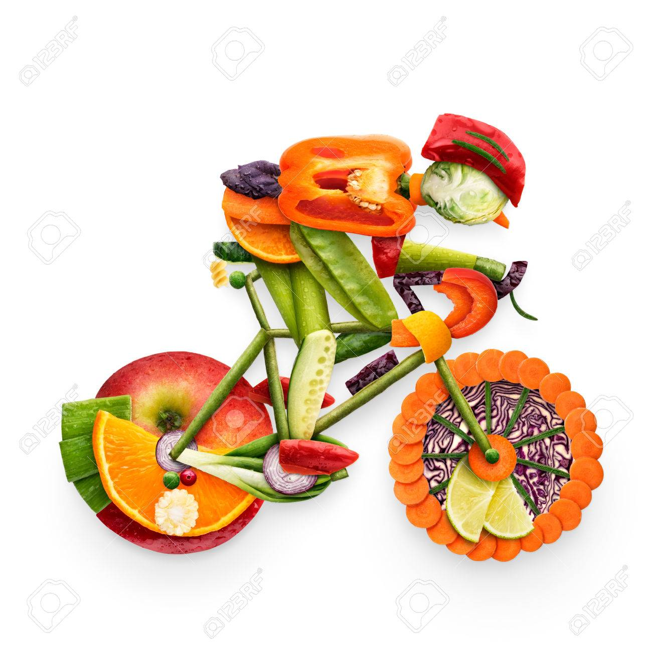 63634780 healthy food concept of a cyclist riding a bike made of fresh vegetables and fruits isolated on whit